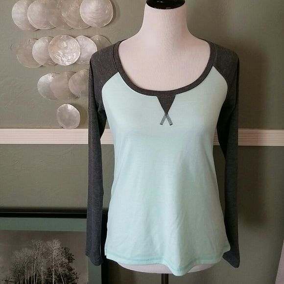 Mint & Gray baseball top I love the style of the shirt & would absolutely love if it fit me like it does the mannequin! It's a really light mint color w/ heather grey & is longer in the back than the front. It is ververy soft and very comfortable to wear. It runs very small and would fit a small, x small or small medium best in my opinion. 70% polyester 30% rayon this is dry-wik  performance wear from Marika tek line. Little bit of piling which I showed in the photo but otherwise very good…