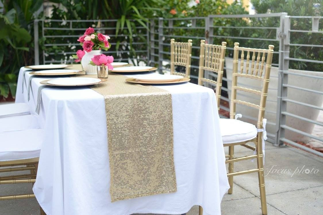 White linens, gold chiavari chairs, gold chargers, gold sequin ...