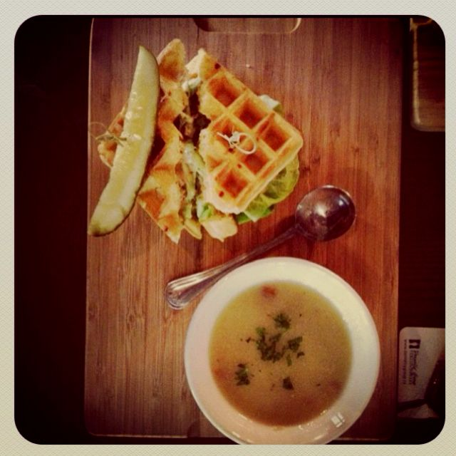 Buttermilk chicken waffle sandwich with pea soup