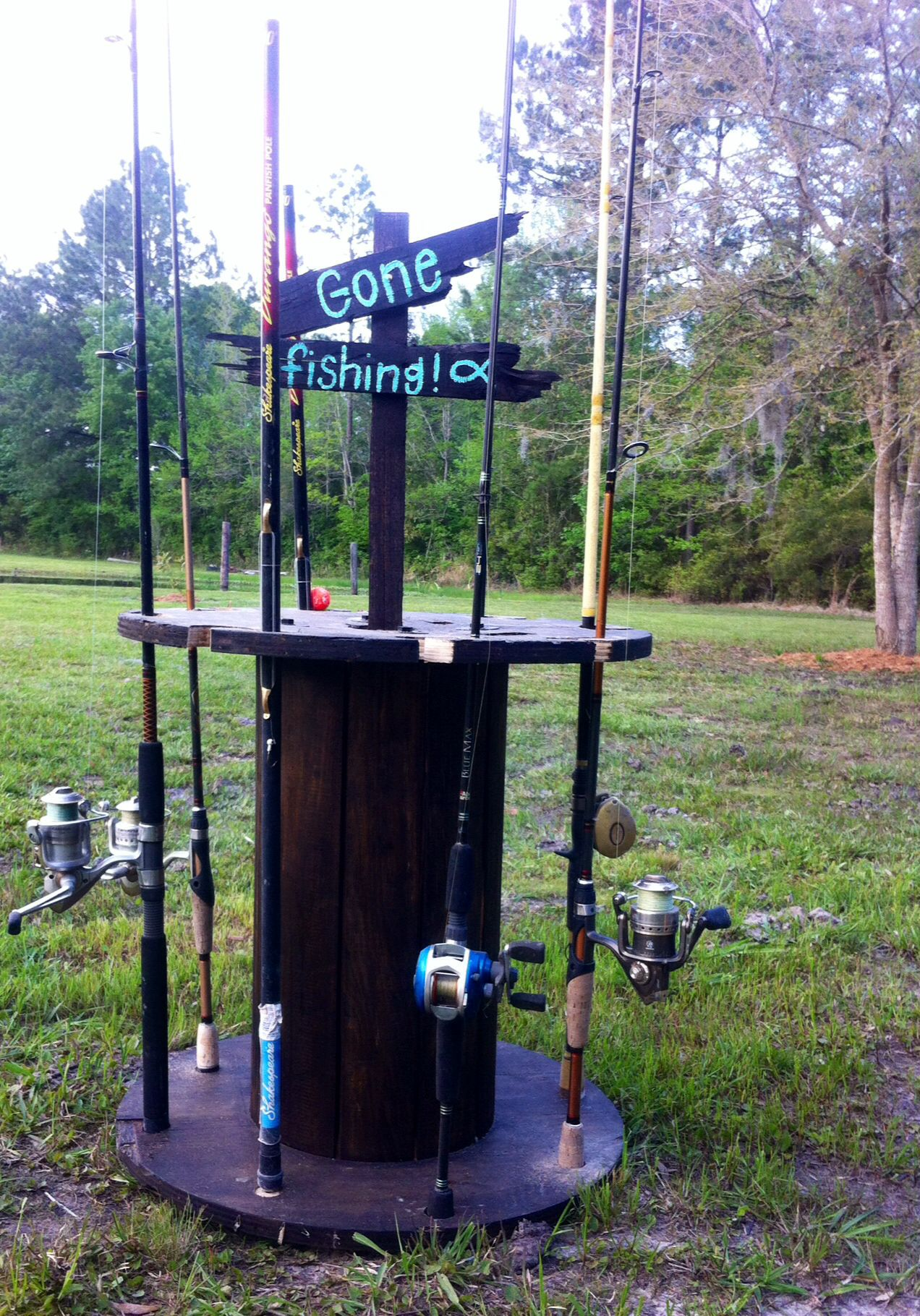 Fishing pole holder I made from an old electric wire spool ...