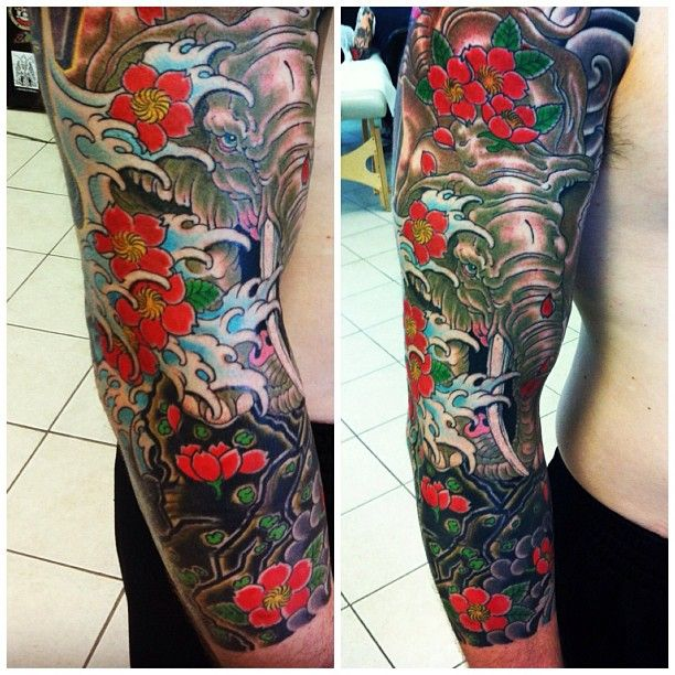 Really Cool Elephant Half Sleeve Tattoo Implementing The