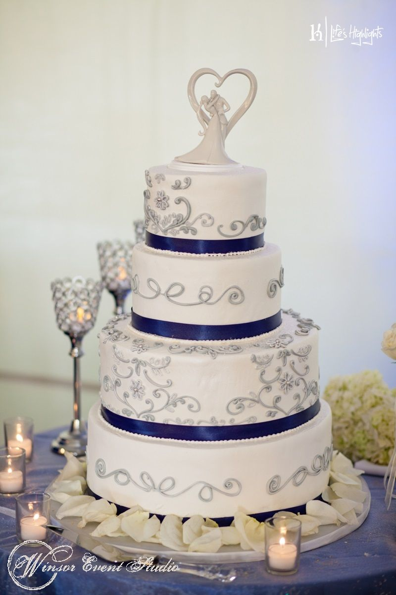 Buttercream wedding cake with silver piped detail and cobalt blue ...