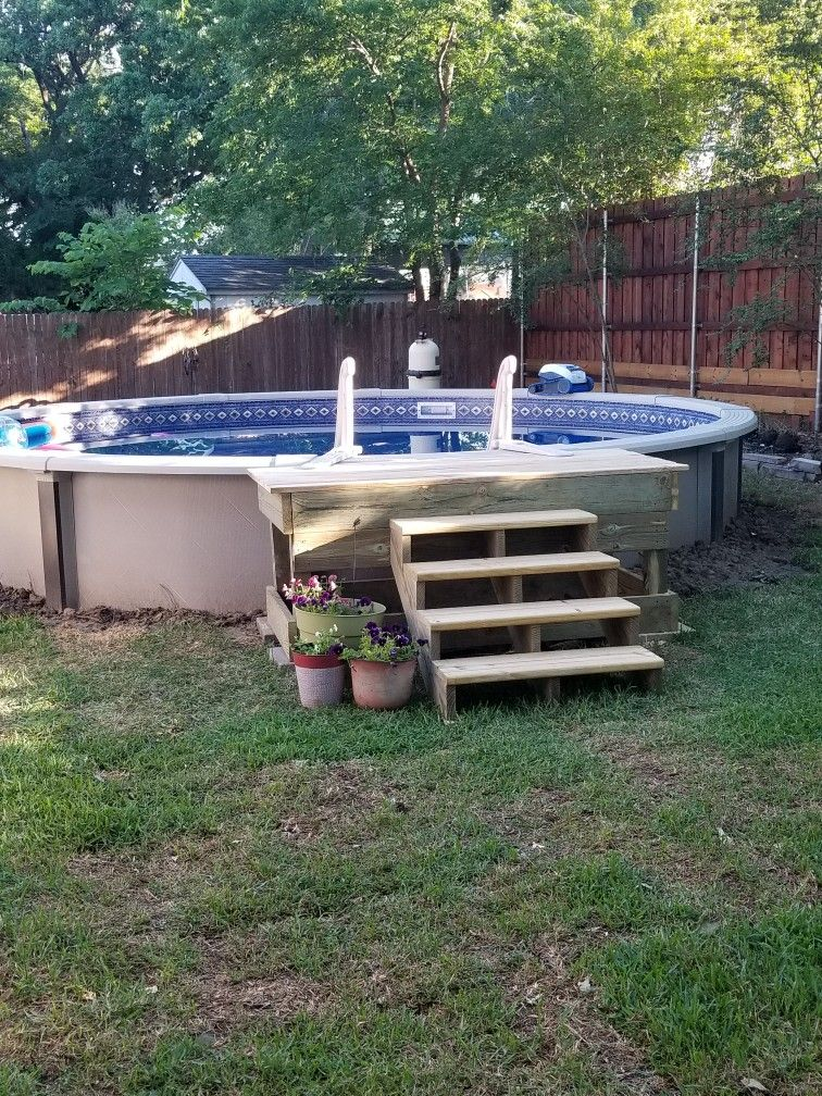 Small Landing Pad With Steps Above Ground Pool Landscaping