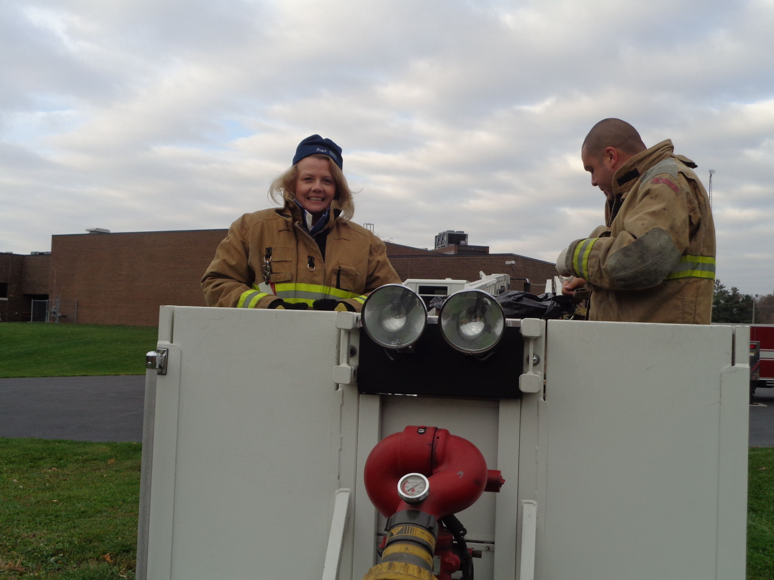 """The entire student body came out to watch the show. Each of the 4th grade classroom teachers; Miss Gustafson, Ms. Herbert and Mrs. Dreibilis climbed into the ladder bucket with firefighter Mike Jernstrom and about a half dozen cardboard boxes packed with the precious pumpkin cargo. The students then counted down and chanted """"drop it, drop it."""" One at a time the containers were dropped over the side of the bucket and landed forcibly on the playground. #WDAPlymouth #PlymouthIndiana"""