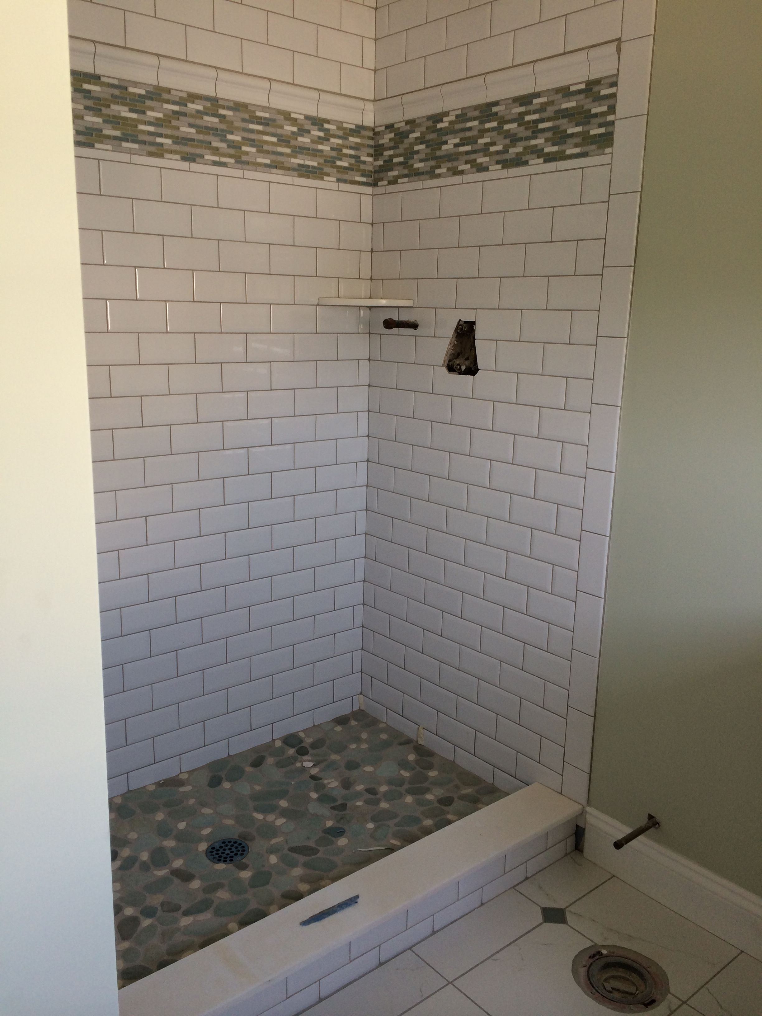 Subway tile w silverado grout glass tile horizontal listello subway tile w silverado grout glass tile horizontal listello river rock shower floor dailygadgetfo Choice Image