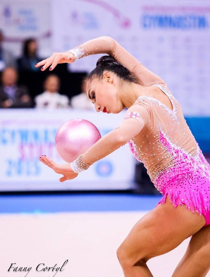 Members of Russias rhythmic gymnastics team perform with