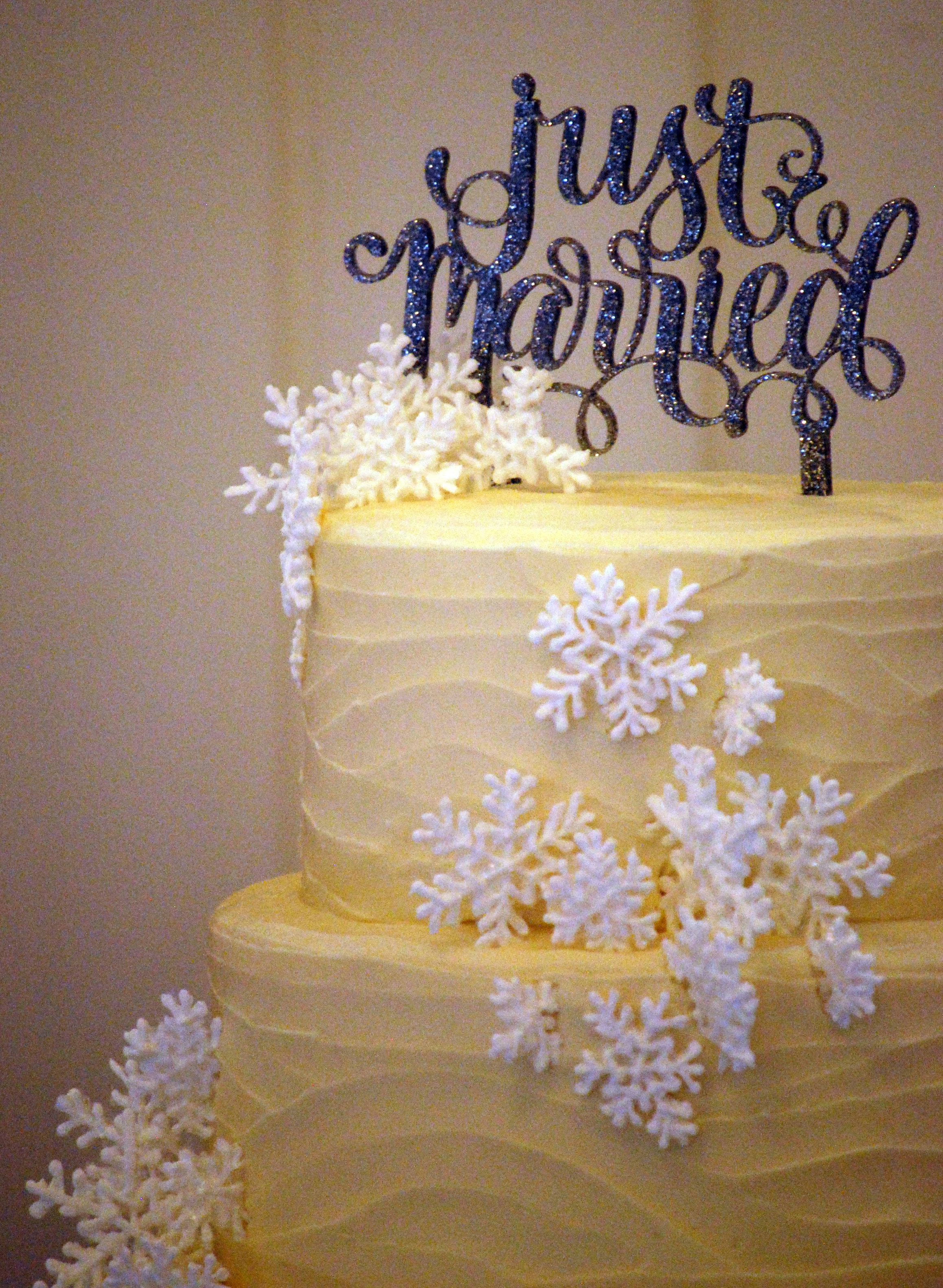 Royal Icing Snowflakes Sprinkled With Edible Glitter For A Winter Wedding Cake