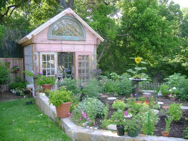 little pink greenhouse with salvaged window