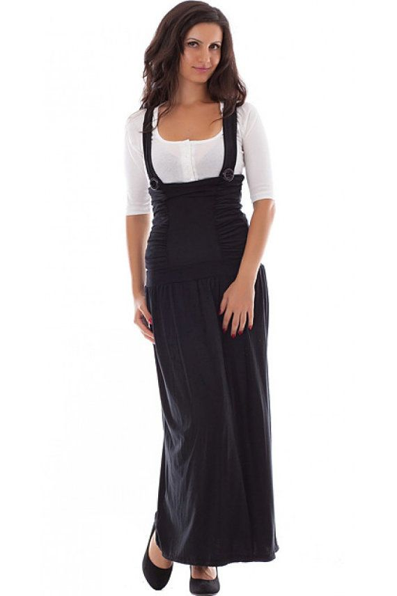 3d6a8ca239b Black jersey pinafore. The pinafore is with crossed straps on the back.