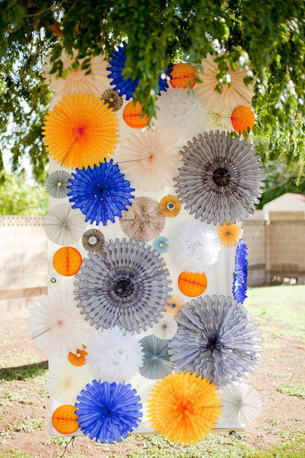 Good idea to attach all the paper wheels/lanterns to one sheet of paper or fabric, so you just have one sheet to hang up the day-of instead of dozens of individual paper decorations