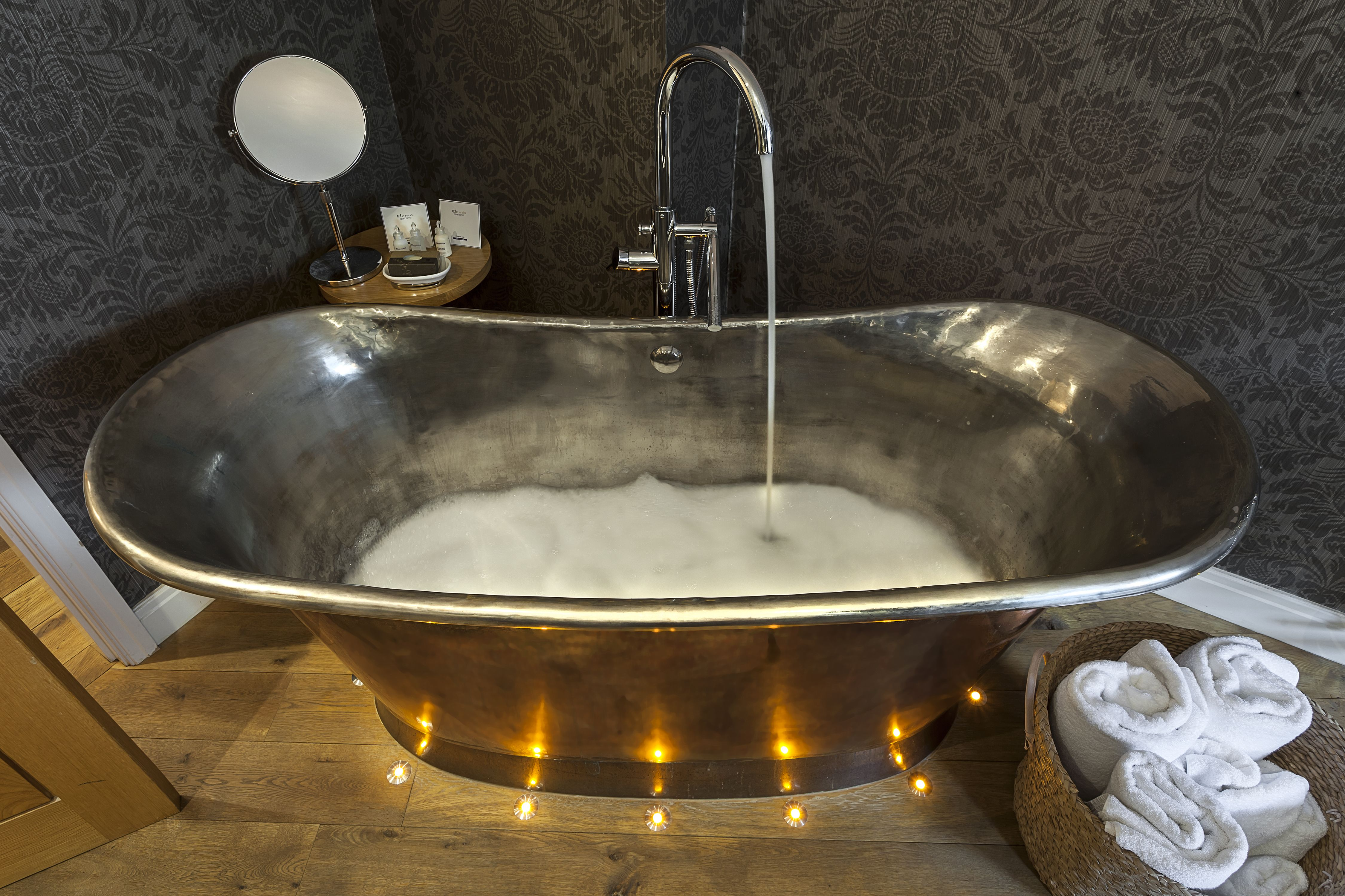 Luxurious bubble bath in our hand crafted Copper roll top