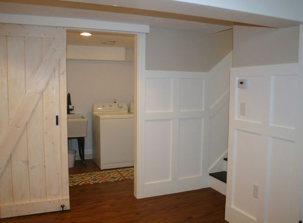 a basement update tour, basement ideas, home decor, laundry room with barn door next to stairs leading back upstairs