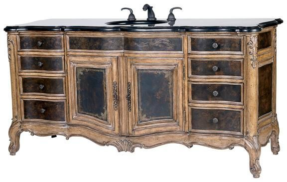 Made from mahogany solids, acid wash, etched brass sheeting, and a golden agate fossil stone top. Includes eight drawers and two doors for plenty of storage.    www.mkhomedesign.com
