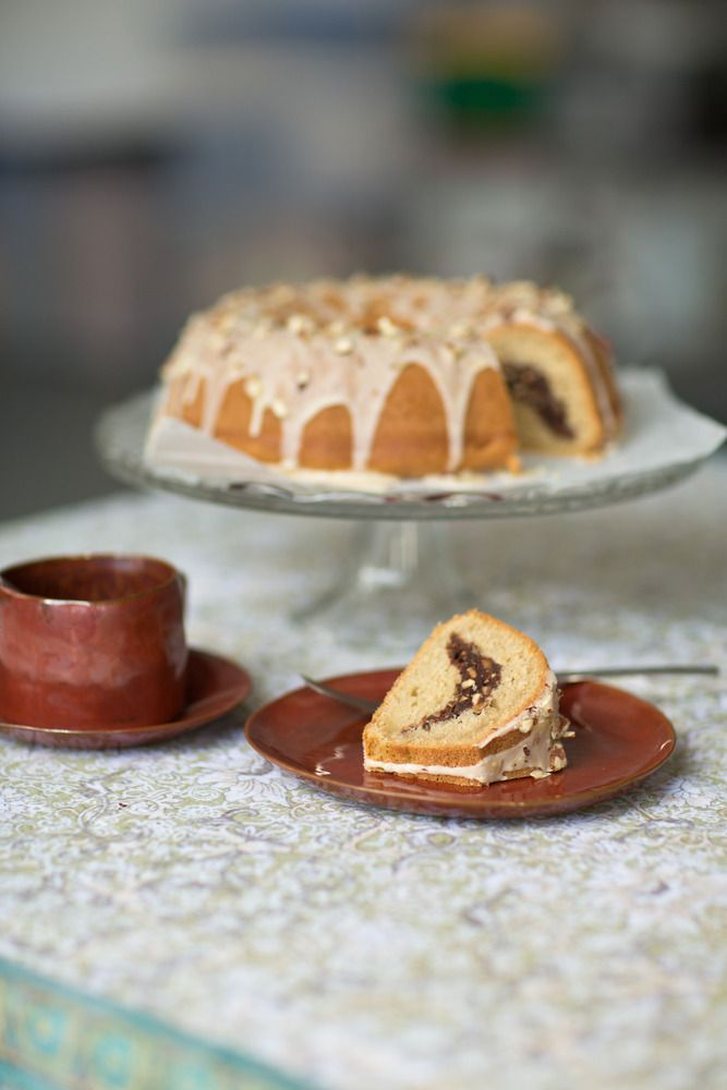 Roasted Hazelnut & Chocolate Bundt. A spiced, nutty centre encased in coconut sponge, this is quite the party piece! www.thatoldchestnutishere.com