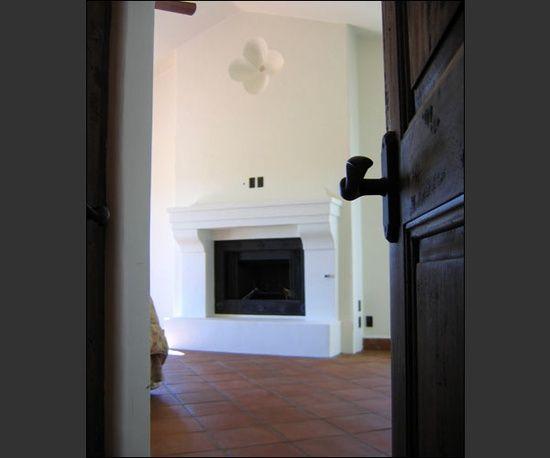 terracotta floors, soft white walls, deep rich wood doors & trim