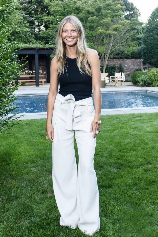 ca3235b662 Gwyneth Paltrow wearing Proenza Schouler Ecru Textured Crepe Wide Leg Pants  and Proenza Schouler Black Silk Cashmere Tank Top