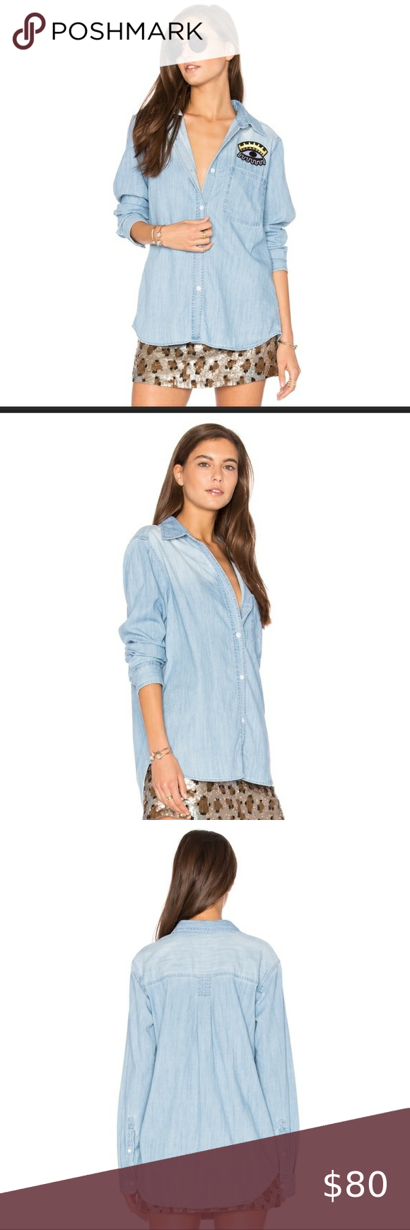 "RAILS embroidered Cleopatra Eye button down shirt RAILS soft chambray button up collared denim shirt with gold Cleopatra Eye patch and pocket on chest. Loose oversized fit, could easily fit a size small as well. Long sleeves with button wrist. High low hem is longer in the back. Nice to wear as a top, cardigan or tie-up front. 85% cotton 15% rayon is super soft and flexible. 29"" length, 19"" bust Women's size extra small XS S New with tag #denimshirt #rails #railsdenimshirt #chambray #chambrayshi"