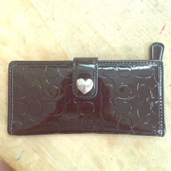 Coach wallet Shiny leather coach wallet with c's and coach heart buckle, zipper for coins on back and lots of pockets and window inside,, perfect condition. Offer!! Coach Bags Wallets