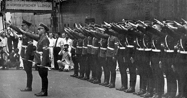 Hitler Youth members arriving at Yokohama, Japan, 16 Aug 1938; in this photo they had just greeted their hosts with 'Dai Nippon banzai' ('Great Japan for Ten Thousand Years')