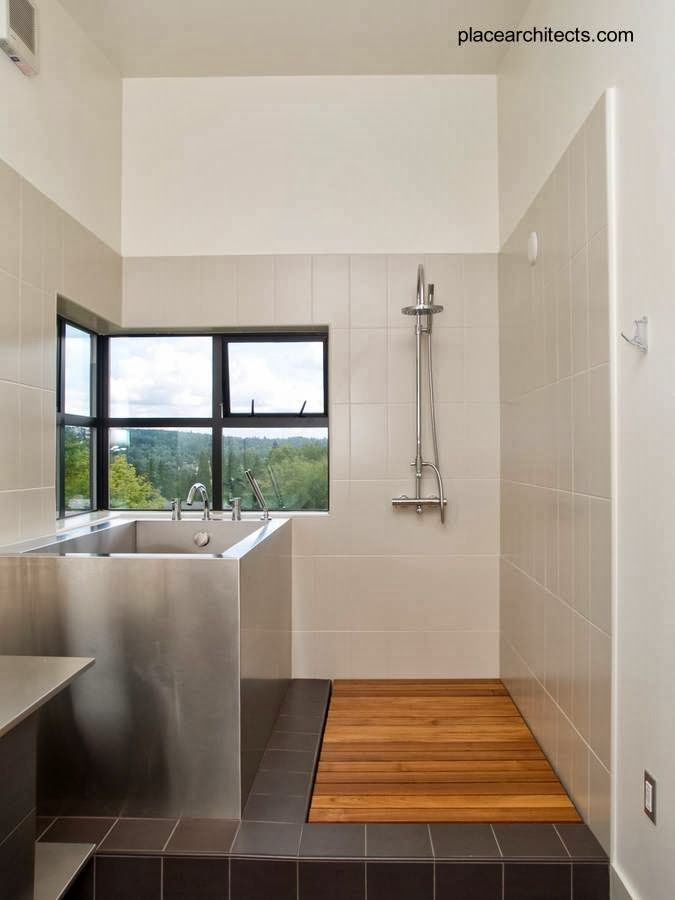 Bathroom in Prefab house in Canada - Baño con bañera de ...