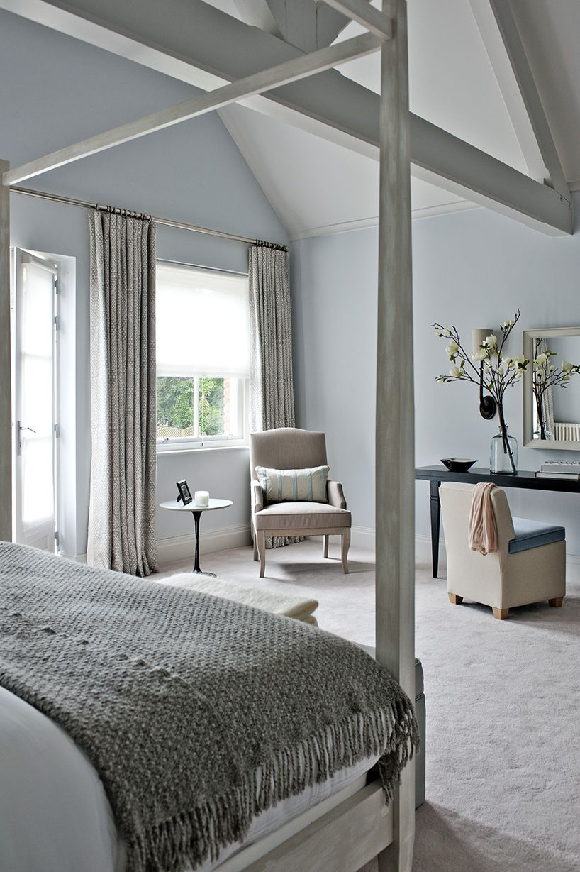 Master bedroom with beams in the roof and light blue walls, four ...