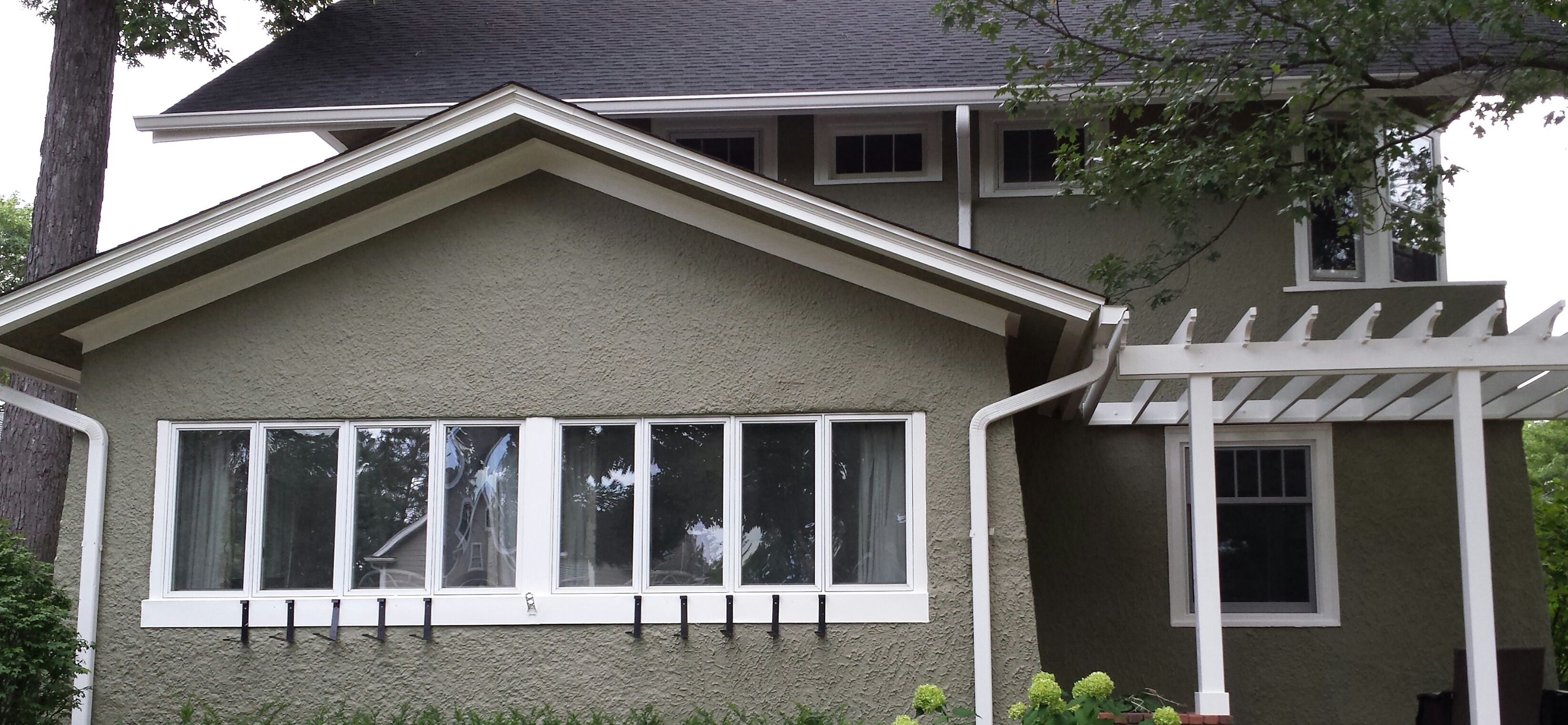 Stucco prairie home newly painted with sherwin williams for Stucco and trim color combinations