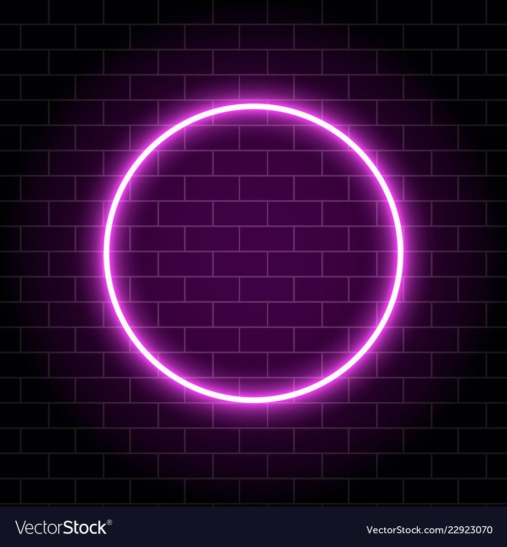 Neon circle lamp isolated on brick wall. Pink glowing