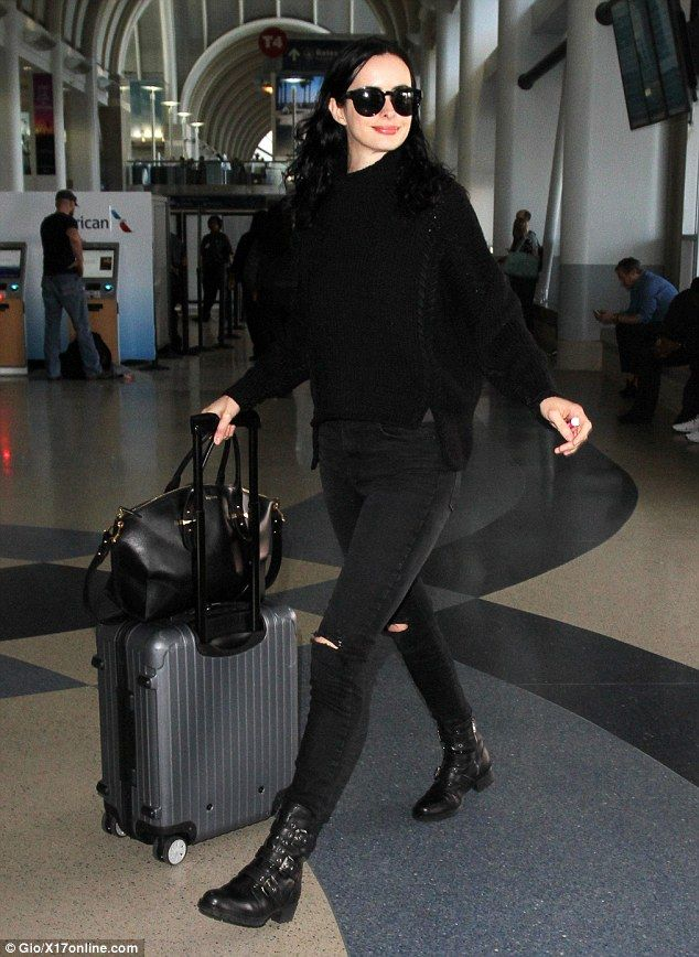 b554a5f9f5c Krysten Ritter rocked black ripped jeans and combat boots as she jetted out  of.