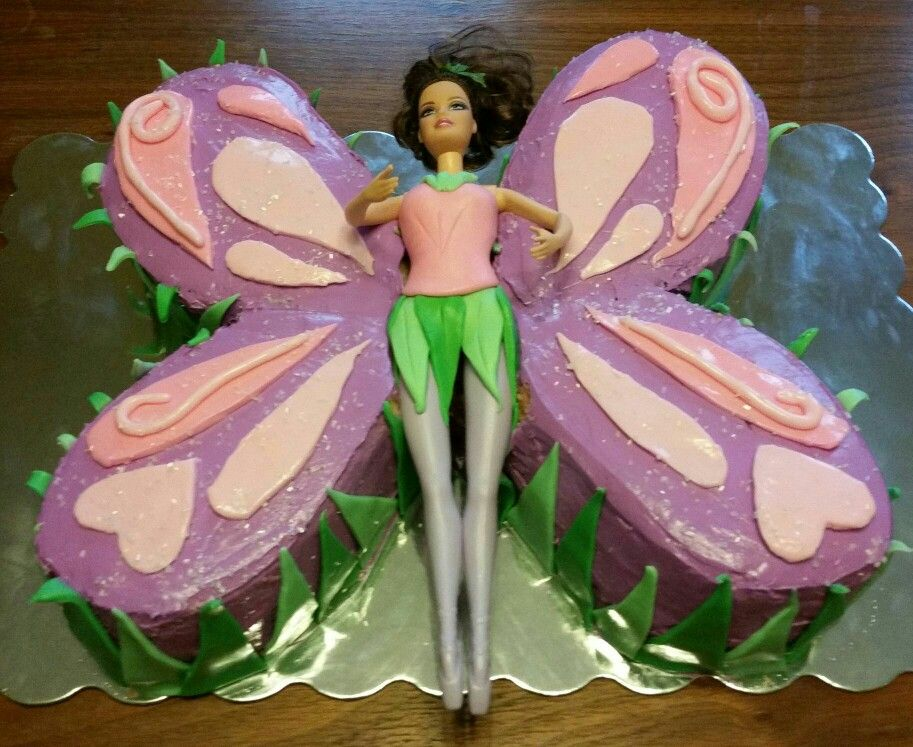Payton's 7th Birthday cake! My first attempt at using fondant.  Fairy party 2015. Andrea Joslin