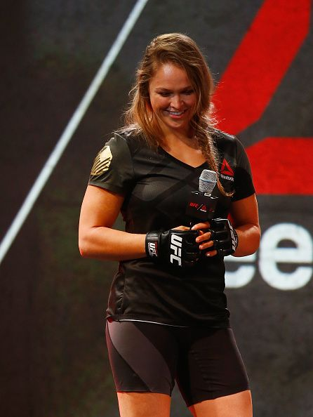 UFC champion Ronda Rousey speaks to Reebok design expert Corinna Werkle  during the Reebok Fight Kit