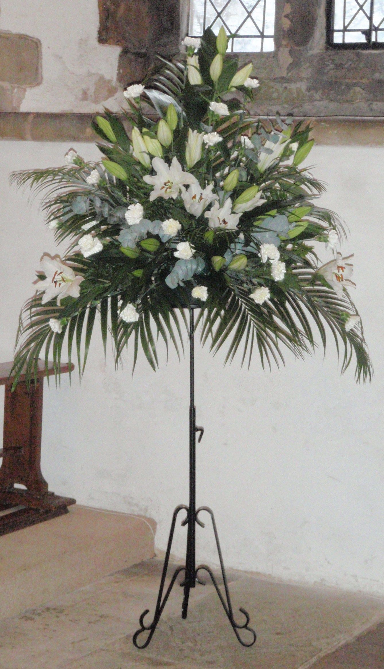 white flower arrangements for church