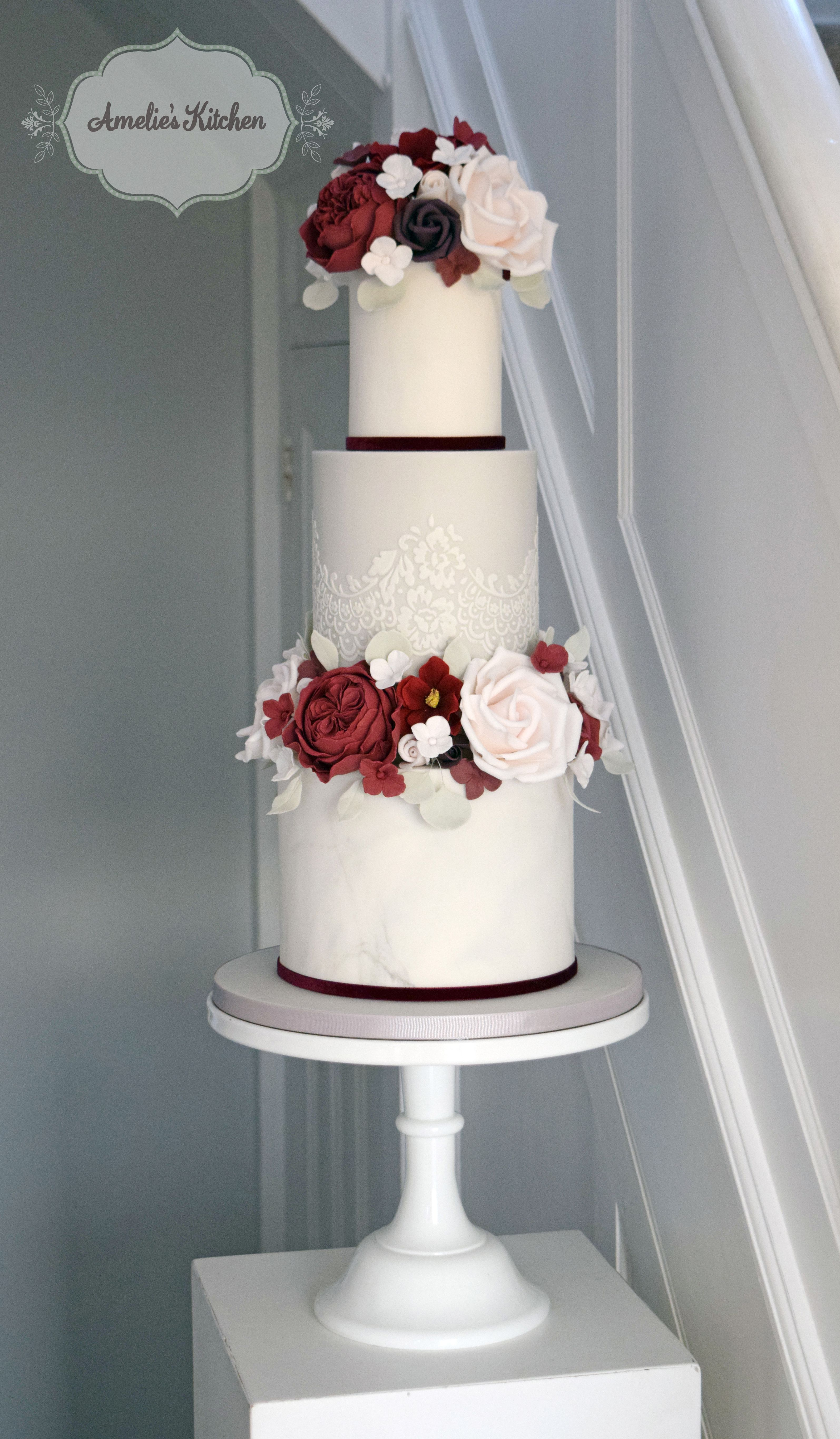 Grey blush and burgundy themed wedding cake design featuring an