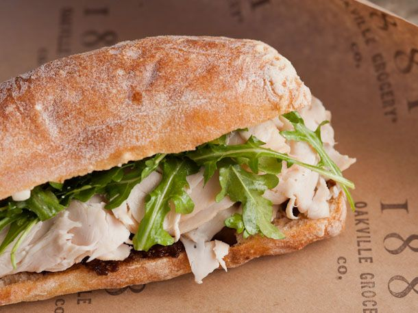 Thin-sliced roasted white meat turkey tops a hearty swath of a sweet, herbaceous fig and fennel marmalade. Topped with a pile of crisp arugula and Bellwether Farms crescenza, the sandwich is served on an Acme ciabatta roll.
