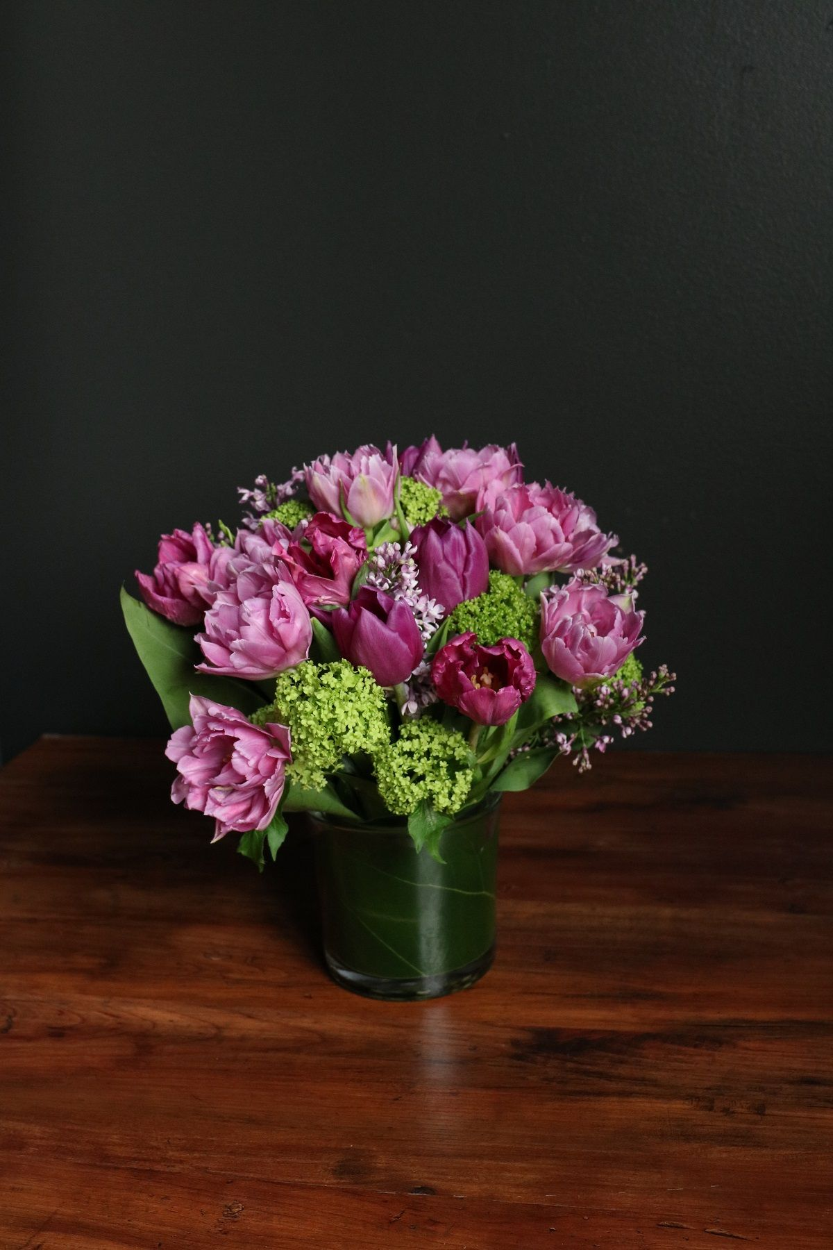 A Romantic Piece With Purple Lilac And Double Tulips Lilac Charm By Winston Flowers Flower Centerpieces Same Day Flower Delivery Flower Delivery