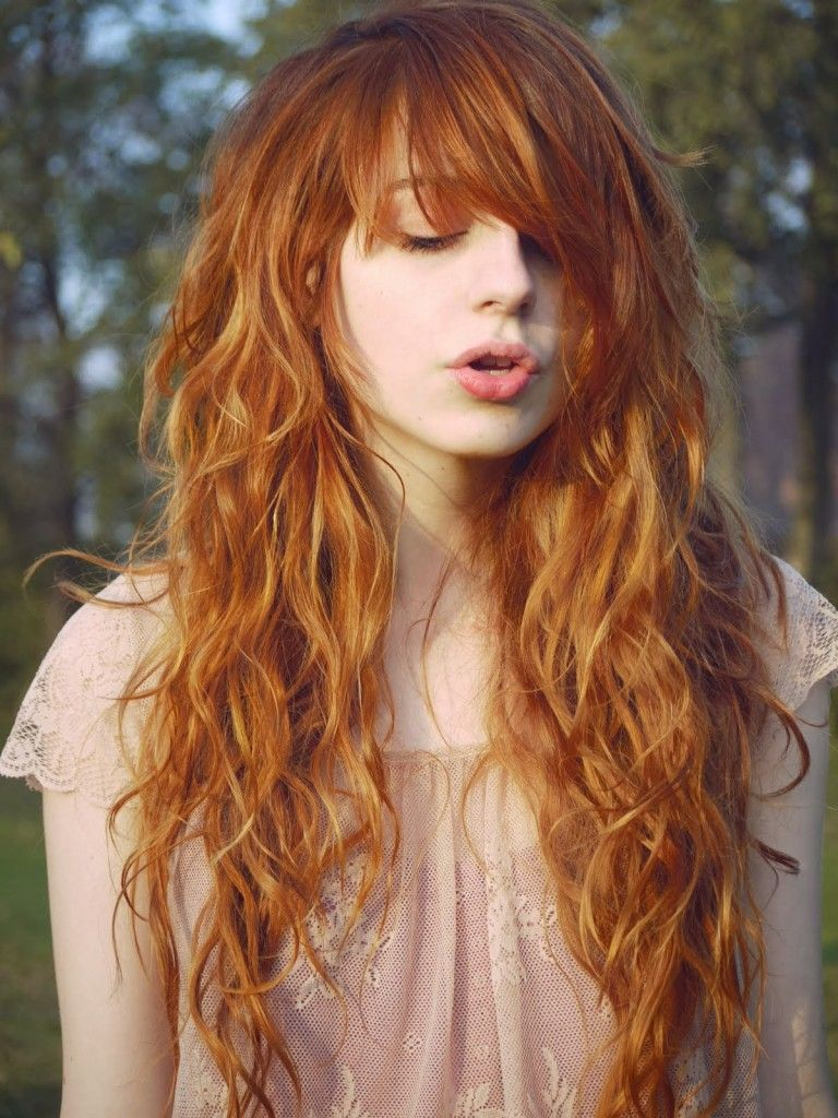 long ginger hair with bangs and messy curls. on the fashion time