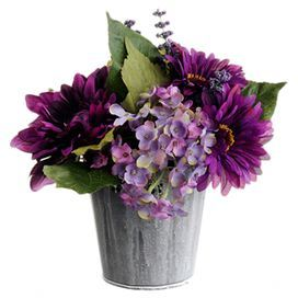 """Bring a touch of natural style to your decor with this lovely faux hydrangea and gerbera daisy arrangement, showcasing vibrant blossoms nestled in a rustic tin pot. Product: Faux floral arrangementConstruction Material: Polysilk and tinColor: Purple, green and silverFeatures: Arrangement includes faux hydrangeas and gerberaDimensions: 11"""" H x 5"""" Diameter"""