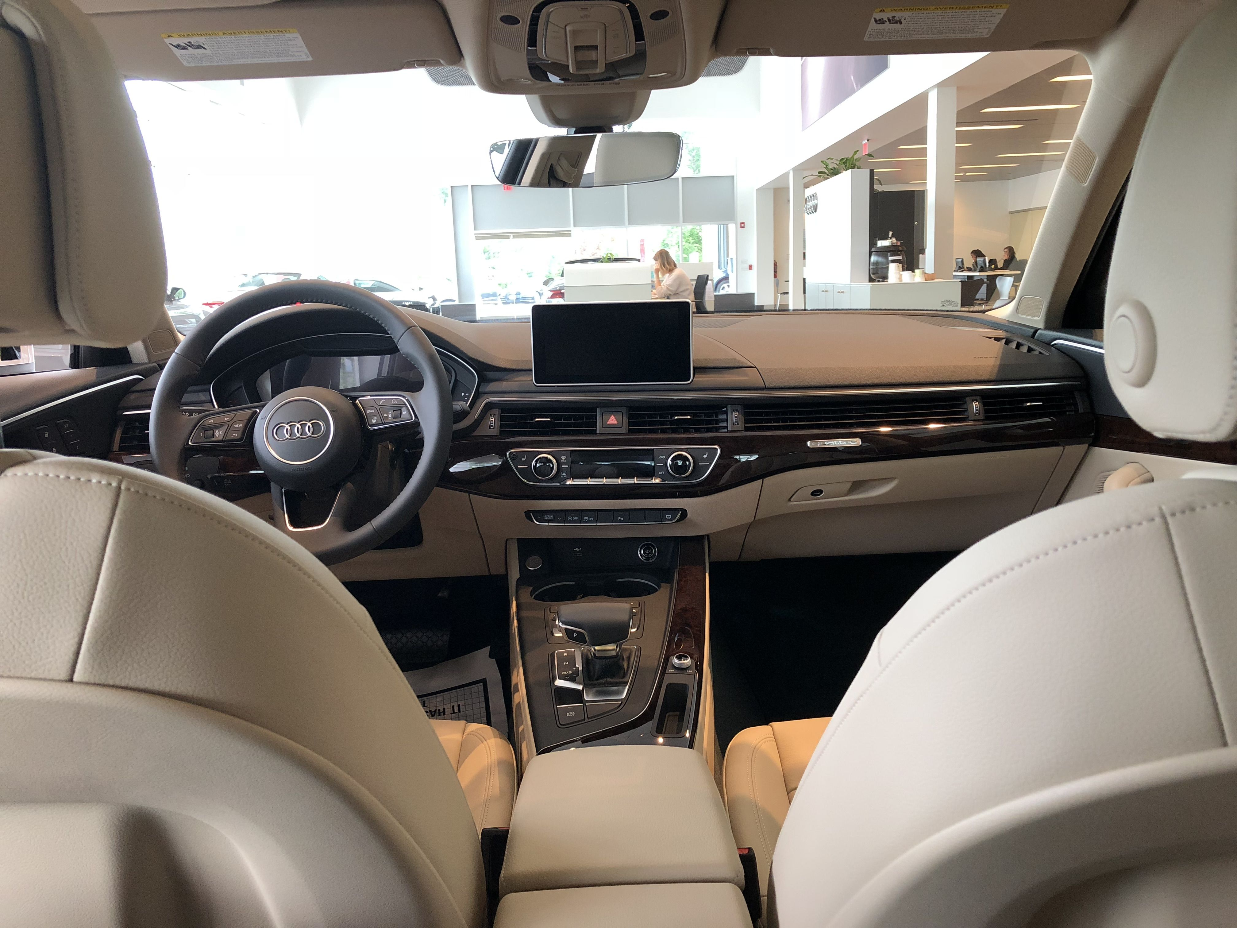 Rear Seat View Of Front Cockpit Of The 2018 Audi A4 In Tan Leather Vehicle Located At Audi Of Bridgewater Nj Audi Interior Audi Dealership Used Luxury Cars