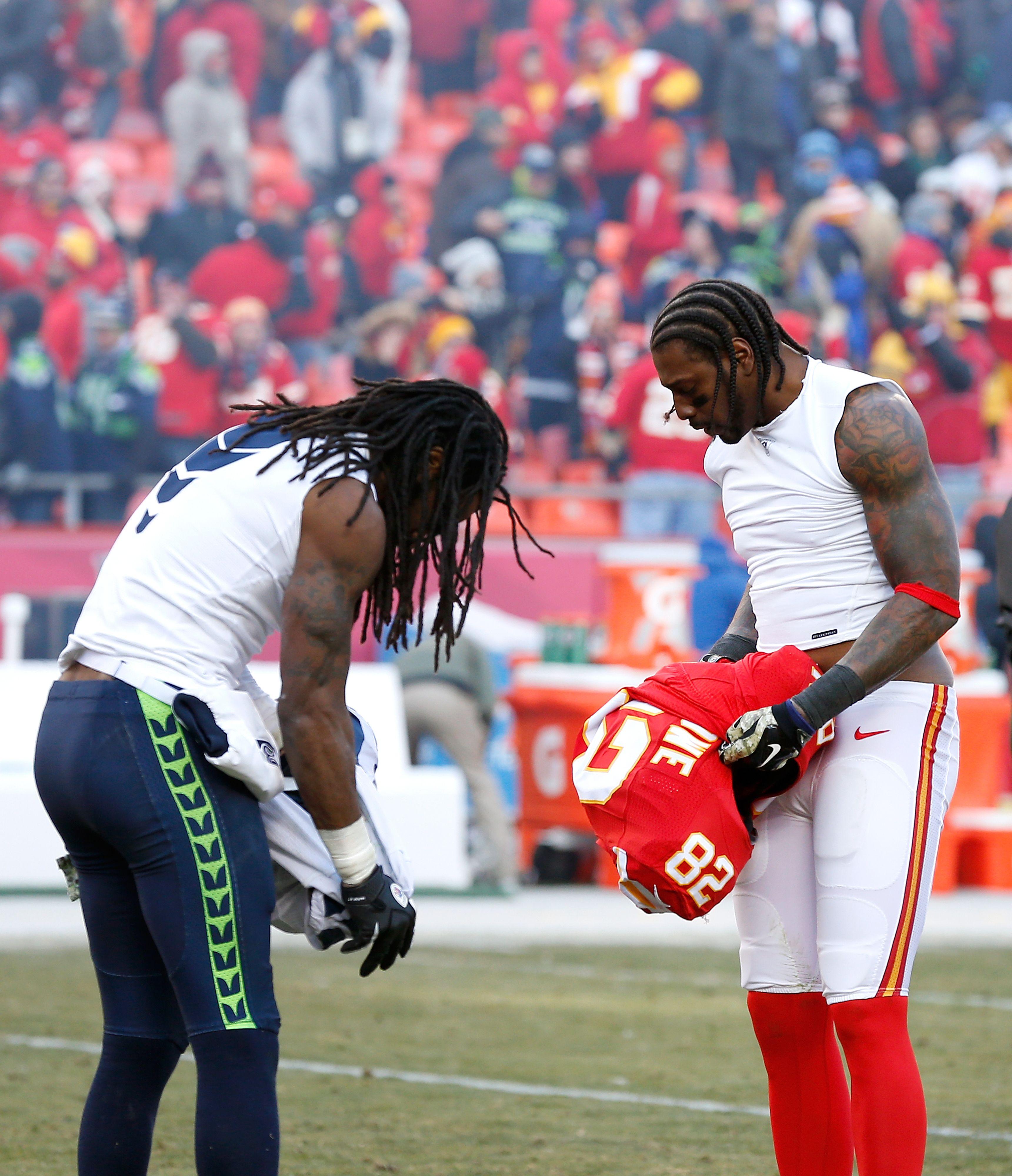 Seattle Seahawks cornerback Richard Sherman (25) and Kansas City Chiefs  wide receiver Dwayne Bowe (82) trade jerseys following an NFL football game  at ...