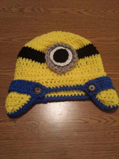 Minion hat with bibs! Why didnt I think of that?? Oh wait I TOTALLY DID!!! NEWEST MINION HAT CRAZE BEGIN!!!!! :) You're welcome Anerica, you're welcome.... lmk if you have questions,  if you're a crochet guru you probably can figure it out, i just single crocheted a strand 25 chains long  (3yo hat size) and sewed it on and put the buttons in front and it turned out amazing!