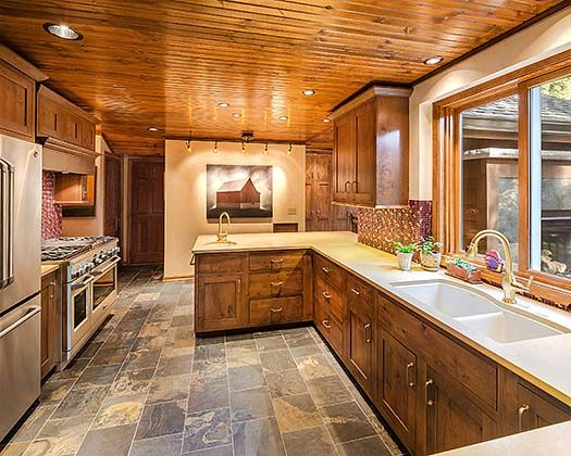 Beau Quartz Counters And Knotty Pine Cabinets