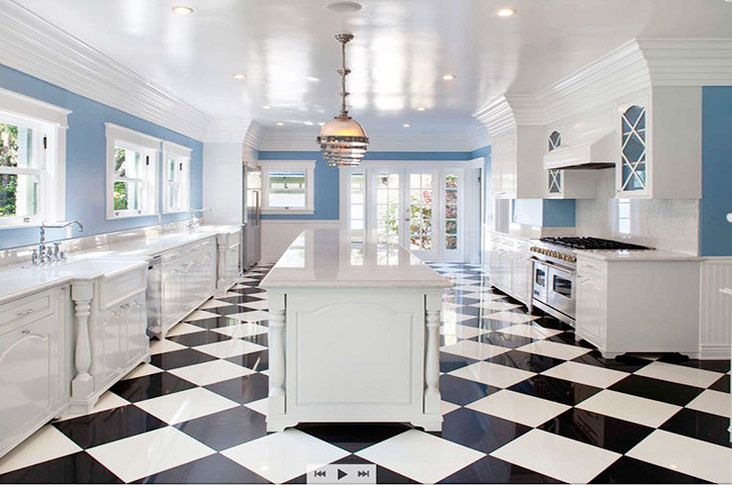 Morgan Brown Designs created a light-filled kitchen with black-and ...