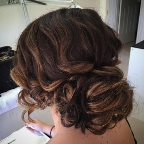 Large Low Curly Bun Updo Curly Hair Updo Curly Hair Styles Side Bun Hairstyles
