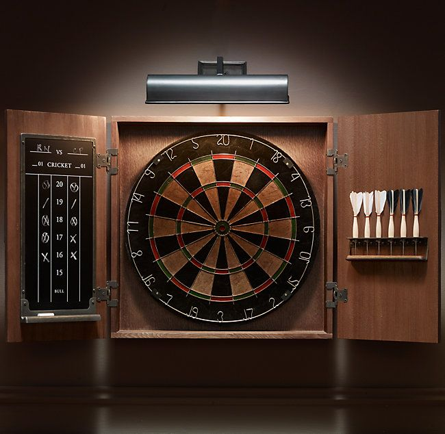 RH's Tournament Dartboard Set:A pub staple on both sides of the pond, darts demands concentration, coordination and no small amount of bravado. Our handsome set encases a self-healing sisal fiberboard, feather-fletched darts and a chalkboard for keeping score, all within an iron-latched oak cabinet.