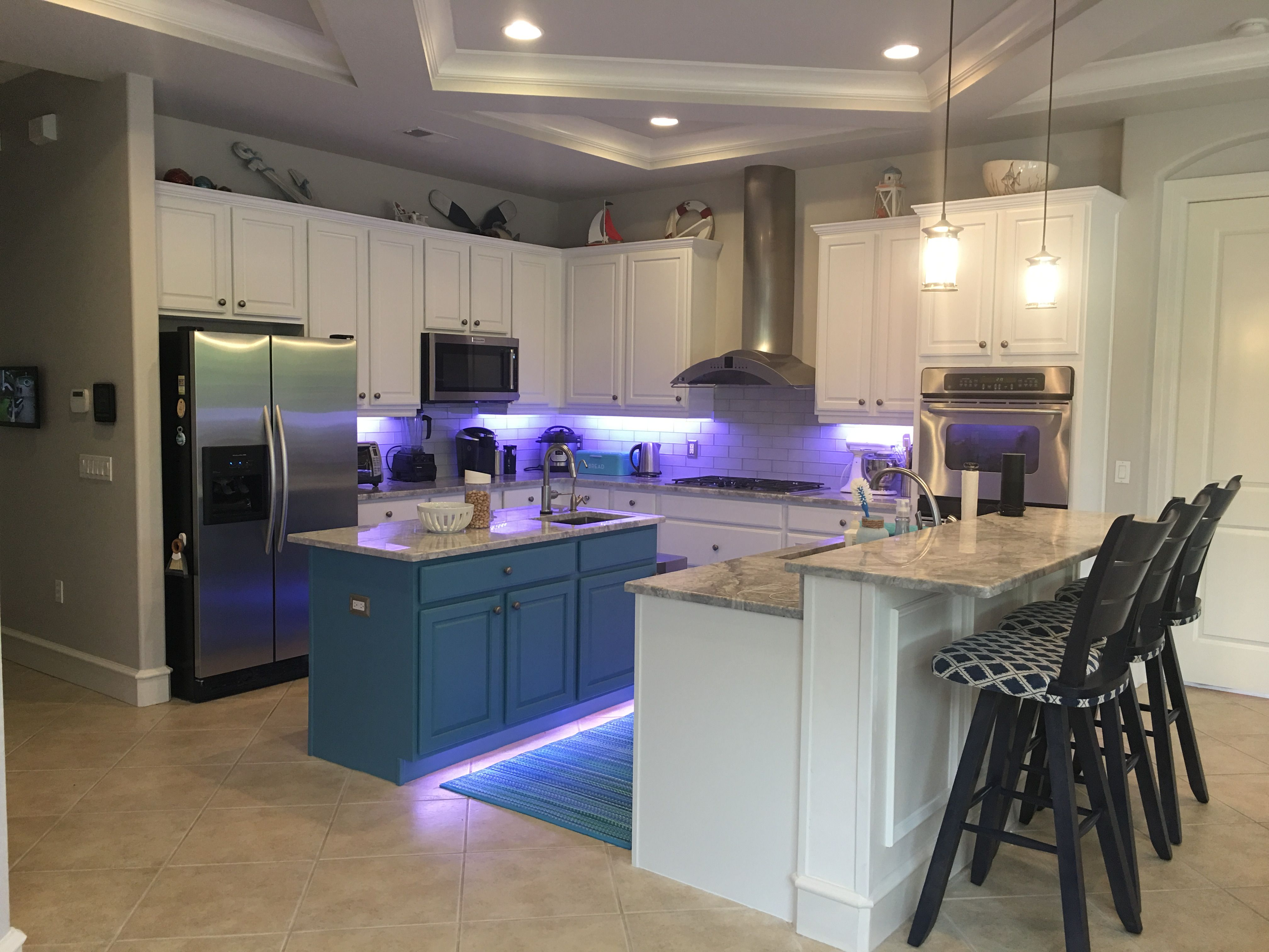 Breakthrough Cabinet Paint Professionally Painted Delicate White And Aqua Blue Island Accent Counters Are Superwhite Quartzite Backsplash Is Gl