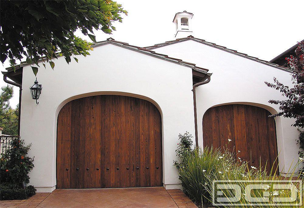 Spanish style wooden gates garage door custom for Door in spanish