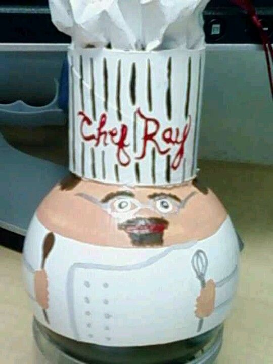 Painted Light bulb, the hat is 1/3 toilet paper roll with newspaper in the top.