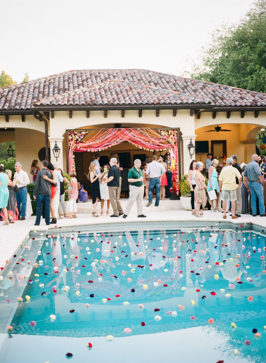 Photography: Esther Louise Photography - estherlouise.com   Read More on SMP: http://www.stylemepretty.com/living/2016/05/04/two-party-tricks-for-the-ultimate-fiesta-pool-garland-and-tequila/