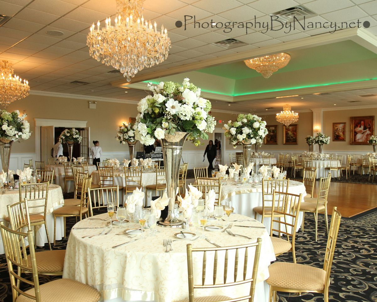 wedding reception ballroom with tall flower vase