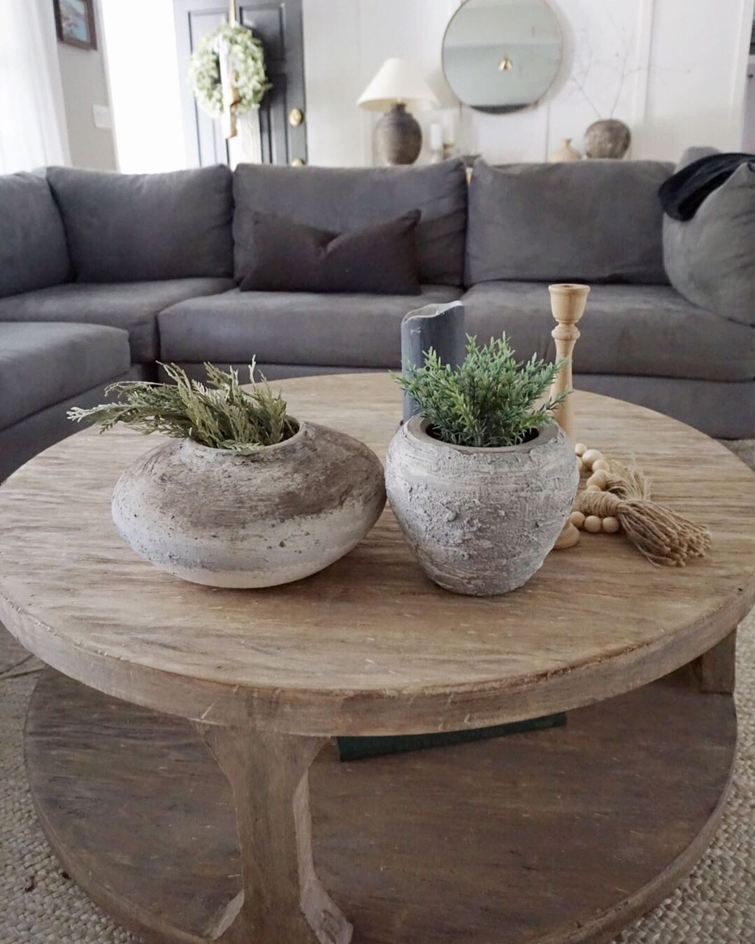 Round Wooden Coffee Table With Diy Rustic Pottery And Grey Couch Grey Sectional Sectional Coffee Table Round Wooden Coffee Table Coffee Table Grey [ 1349 x 1080 Pixel ]
