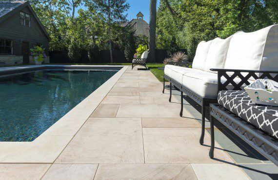 pool and patio with natural stone from unilock photos pool